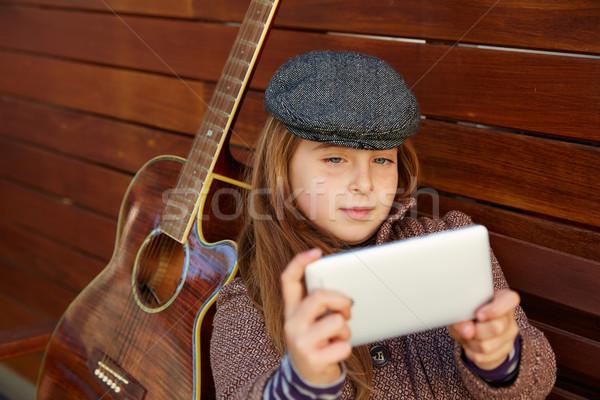 blond kid girl taking selfie guitar and winter beret Stock photo © lunamarina