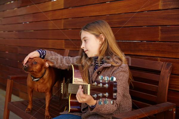 Kid девушки играет гитаре собака зима Сток-фото © lunamarina