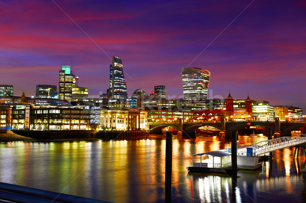 London skyline sunset on Thames river Stock photo © lunamarina