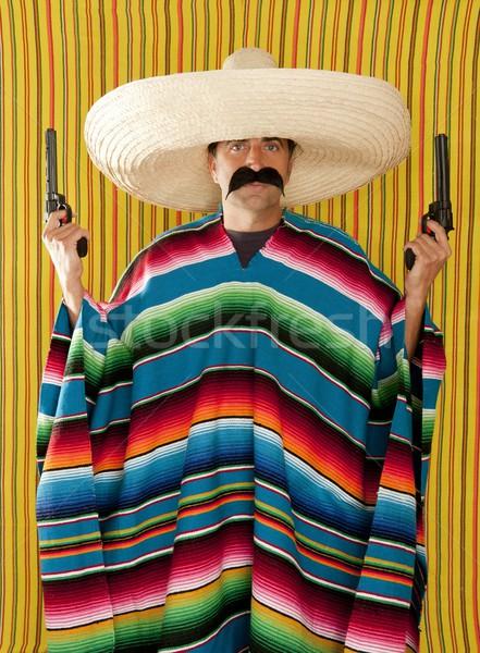 Bandit Mexican revolver mustache gunman sombrero Stock photo © lunamarina
