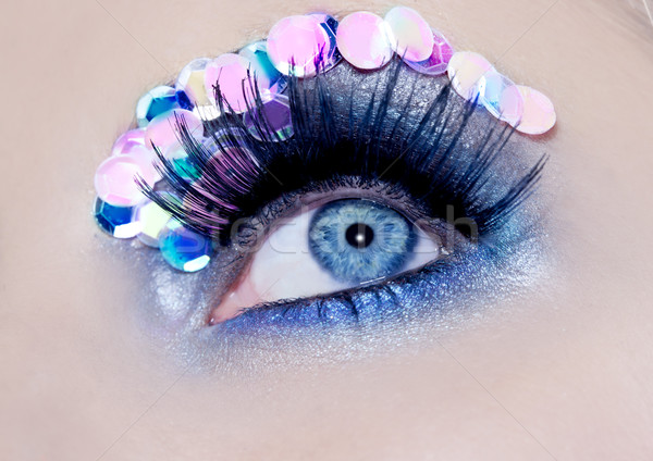 Blue eye macro closeup makeup sequins colorful Stock photo © lunamarina