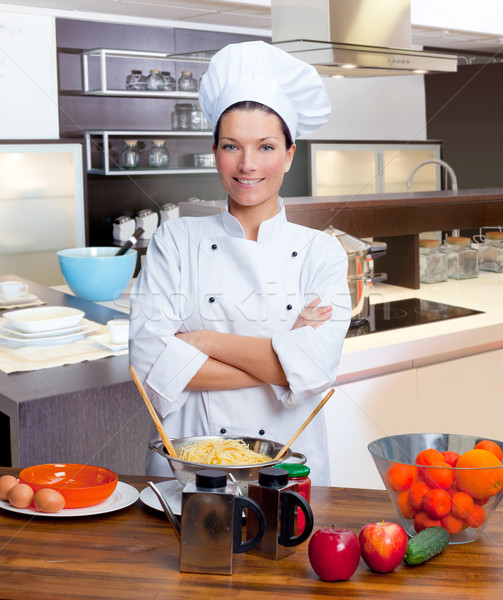 Chef woman portrait in the kitchen Stock photo © lunamarina