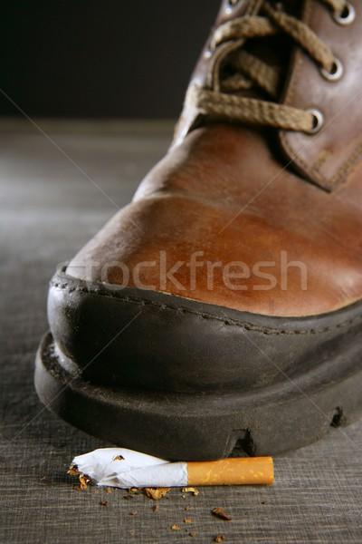 broken cigarette tread by a boot Stock photo © lunamarina