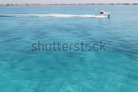Blue turquioise Caribbean sea fishing boat Stock photo © lunamarina