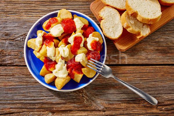 Tapas Patatas Bravas potatoe fries with tomato Stock photo © lunamarina