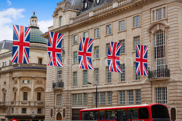London Bus and UK flags in Piccadilly Circus Stock photo © lunamarina