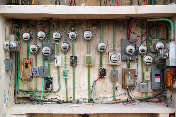 Stock photo: electric meter messy electrical wiring installation