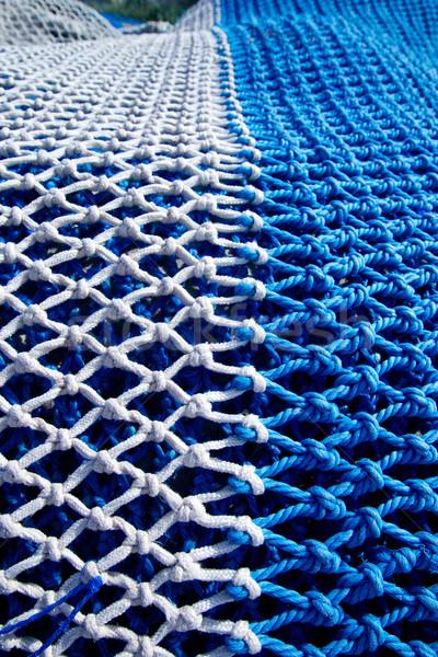 blue and white fishing ntes with rope knots Stock photo © lunamarina