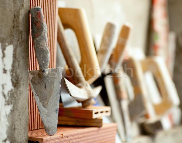 Budowy mason cementu narzędzia rząd budynku Zdjęcia stock © lunamarina