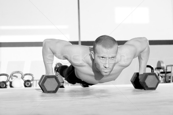 Gym man push-up strength pushup with dumbbell  Stock photo © lunamarina