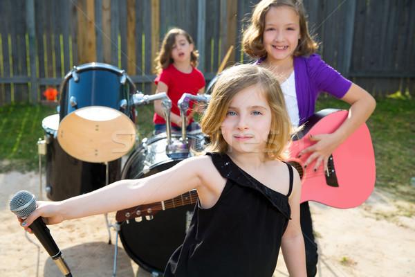 Cantora menina cantando jogar viver banda Foto stock © lunamarina