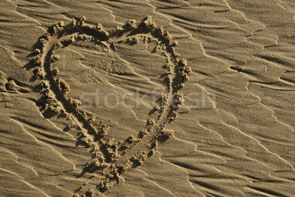 hearth draw on the beach sand surface Stock photo © lunamarina