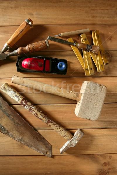 carpenter tools saw hammer wood tape plane gouge Stock photo © lunamarina
