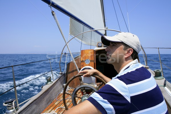 Sailor sailing in the sea. Sailboat over blue Stock photo © lunamarina