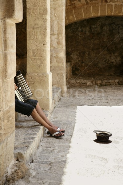 Beggar hidden accordion musician with hat Stock photo © lunamarina