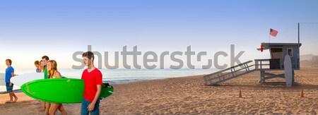 Surfer teen boys girls walking on California beach Stock photo © lunamarina