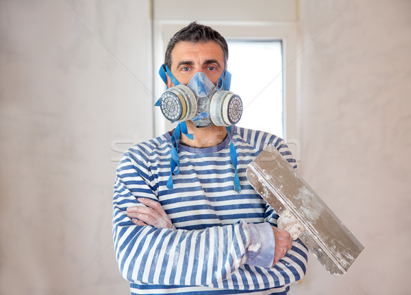Funny plastering man mason with protective mask and trowel Stock photo © lunamarina