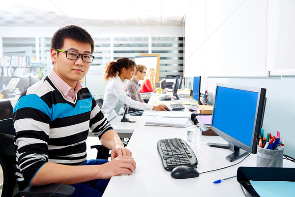 Asian businessman young in office with computer Stock photo © lunamarina
