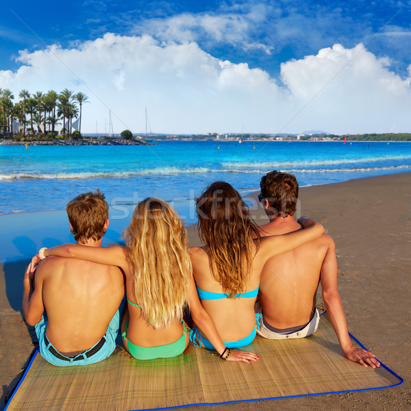 friends group couples sitting beach sand rear view Stock photo © lunamarina