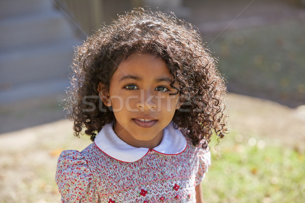 Kisgyerek gyerek lány portré nemzetiség virágok Stock fotó © lunamarina