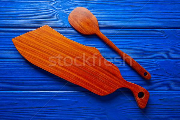 Chef tool spatula and table board on blue Stock photo © lunamarina