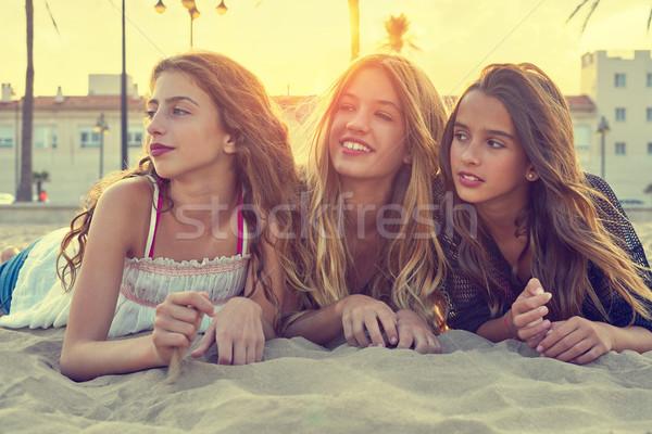 Best friends girls at sunset beach sand Stock photo © lunamarina