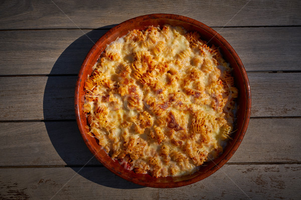 pasta Fisarmoniche gratin with cheese and tomato Stock photo © lunamarina