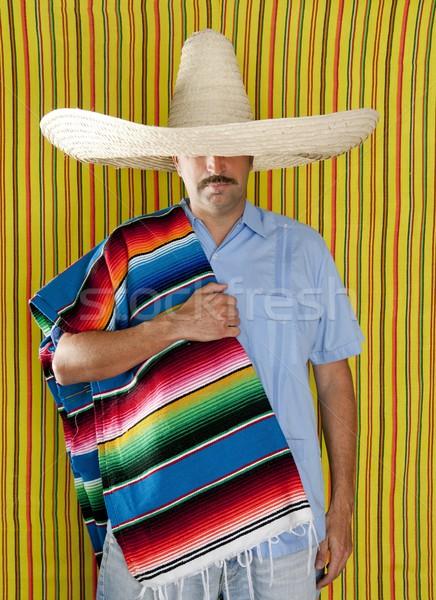 Mexican man serape poncho hat sombrero Stock photo © lunamarina