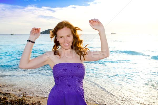 Stock photo: Dancing girl at Ibiza sunset in Cala Conta
