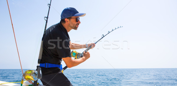 blue sea offshore fishing boat with fisherman Stock photo © lunamarina