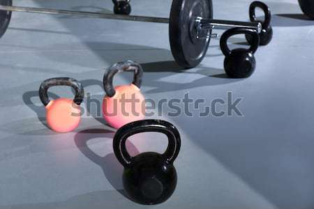 Kettlebells at crossfit gym with lifting bars Stock photo © lunamarina