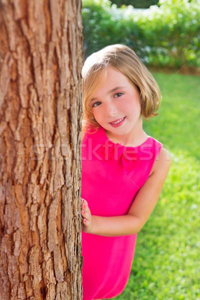 child happy girl smiling rear tree trunk in garden Stock photo © lunamarina
