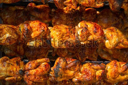 Roasted chicken in a row turning on a roaster Stock photo © lunamarina
