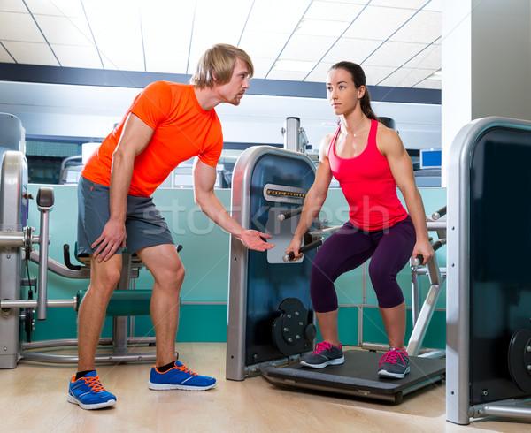 Gym squat machine exercise workout fit woman Stock photo © lunamarina
