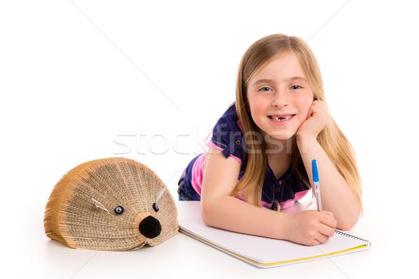 Blond kid girl student with hedgehog book Stock photo © lunamarina