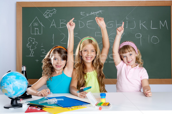 clever kids student group at school classroom Stock photo © lunamarina