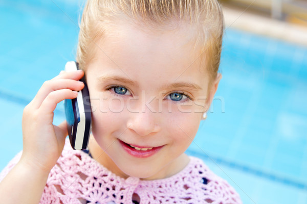 Stock photo: blond child little girl talking mobile phone