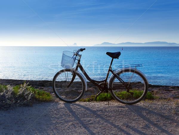 Bicycle in formentera beach with Ibiza sunset Stock photo © lunamarina