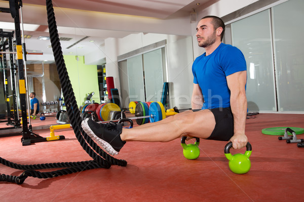 Stock photo: Crossfit fitness man L-sits Kettlebells L sits exercise