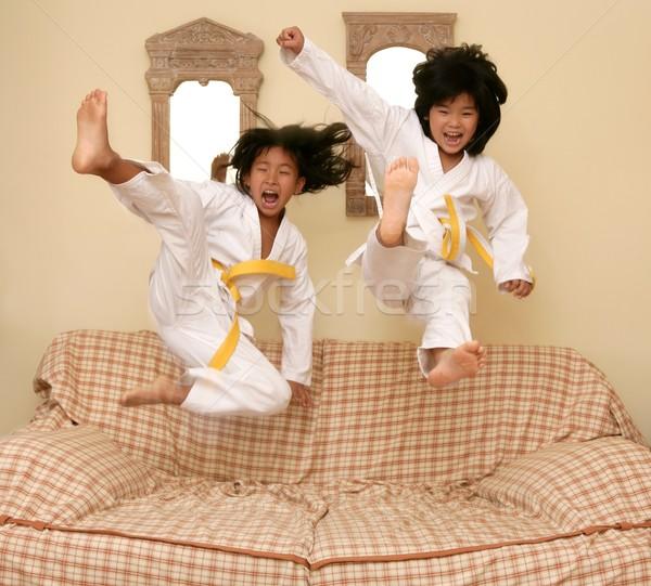 Dos pequeño Asia judo ir sofá Foto stock © lunamarina