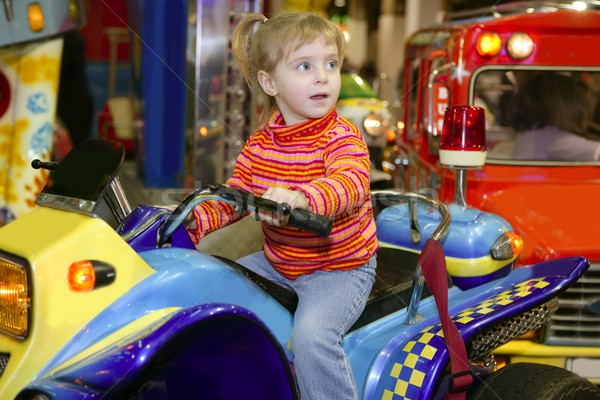 blond little girl in funfair fairground attraction Stock photo © lunamarina