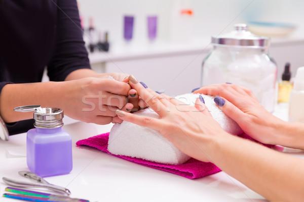 Nails saloon woman nail polish remove with tissue Stock photo © lunamarina