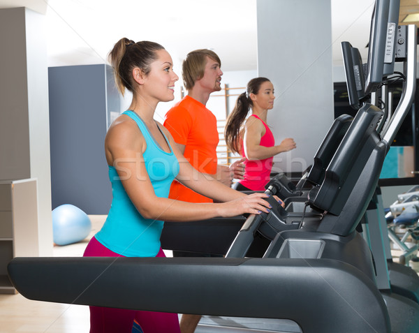 Gym treadmill group running indoor Stock photo © lunamarina
