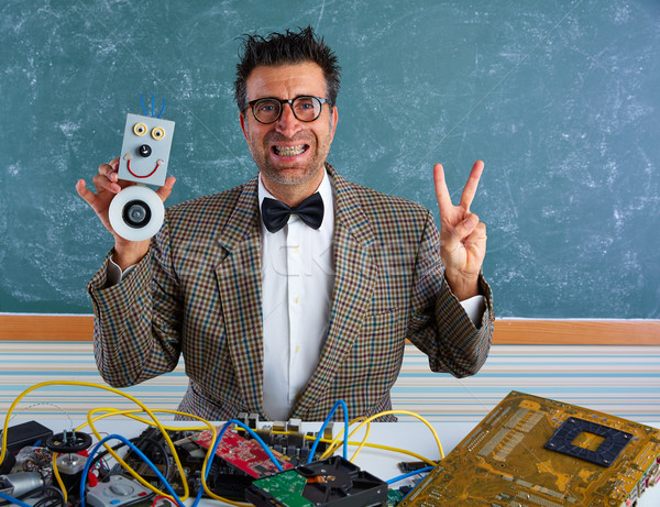 Nerd electronics technician silly winner gesture Stock photo © lunamarina