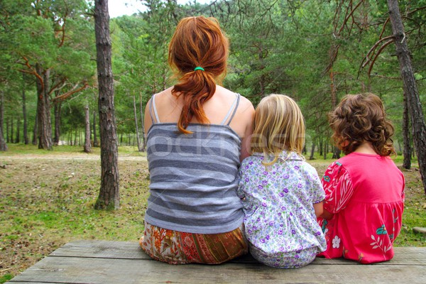 mother and daughters sitting back park forest Stock photo © lunamarina