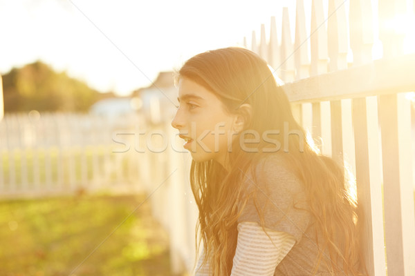Tween kid girl profile in the park at sunset Stock photo © lunamarina
