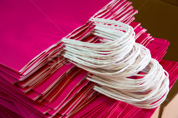 Paper bags atacked in a factory pink color Stock photo © lunamarina
