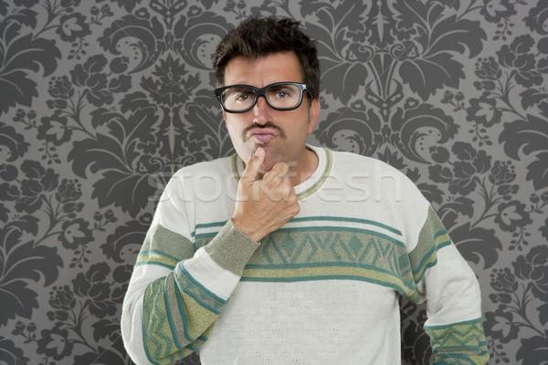 Stock photo: nerd pensive silly man retro wallpaper glasses tacky