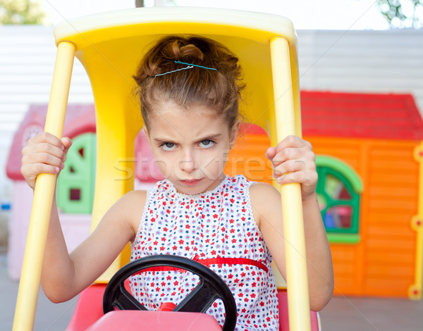 Stock photo: Angry toy car driver children girl