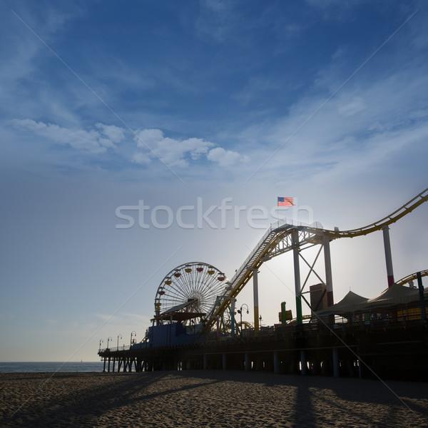 Santa Moica pier Ferris Wheel at sunset in California Stock photo © lunamarina